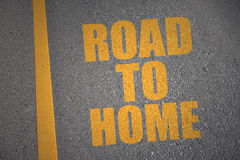 Asphalt road with text road to home near yellow line Stock Photo