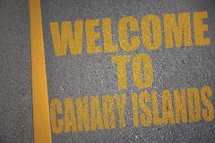 Asphalt road with text welcome to canary islands near yellow line. Concept Royalty Free Stock Photo