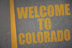 asphalt road with text welcome to colorado near yellow line Royalty Free Stock Photography