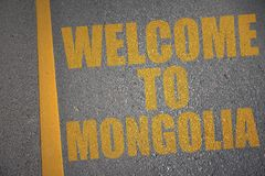 asphalt road with text welcome to mongolia near yellow line. Royalty Free Stock Photography