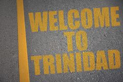 Asphalt road with text welcome to trinidad near yellow line. Concept Stock Image