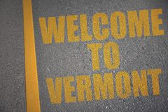 asphalt road with text welcome to vermont near yellow line. Royalty Free Stock Images