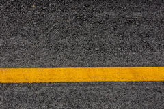 Asphalt road texture background with yellow stripes Royalty Free Stock Image