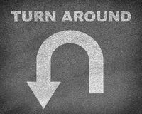 Asphalt road texture with U-turn sign and text Stock Photography