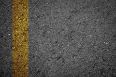Asphalt Road texture with yellow strip Royalty Free Stock Photography