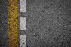 Asphalt Road texture with yellow strip and white strip Stock Image