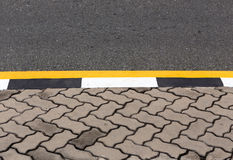Asphalt road texture with yellow stripe Royalty Free Stock Photo