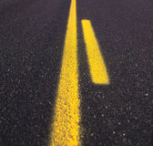 Asphalt road texture. With yellow stripe Royalty Free Stock Images