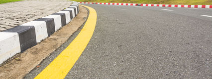 Asphalt road texture with yellow stripe Royalty Free Stock Image
