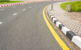 Asphalt road texture with yellow stripe royalty free stock photography