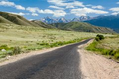 Asphalt road in Tien Shan mountains Stock Photography