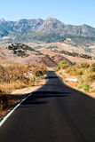 Asphalt road to Andalusian mountains Royalty Free Stock Photos