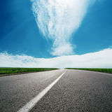 Asphalt road to cloudy horizon Royalty Free Stock Image