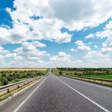 Asphalt road to cloudy horizon Royalty Free Stock Images