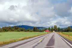 Asphalt road to the country house in the mountains Stock Photos