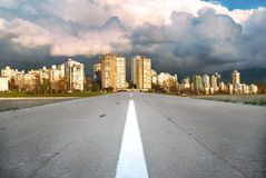 Asphalt road to modern business city Royalty Free Stock Photo