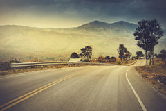Asphalt road to the mountain royalty free stock photography