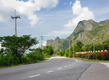 Asphalt road to the mountain range in Khao Sam Roi Yot National Park in Thailand stock images