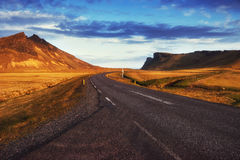 Asphalt road to the mountains. Beauty world Iceland Royalty Free Stock Photo