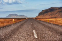 Asphalt road to the mountains. Beauty world Iceland Stock Photos
