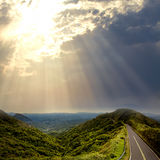 Asphalt road to the mountians Stock Image