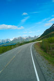 Asphalt road to Norvegian mountains. In summer clear day Royalty Free Stock Photography