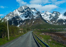 Asphalt road to Norwegian mountains Royalty Free Stock Image