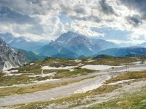 Asphalt road to parking place in National Nature Park Tre Cime Stock Photos