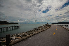 Asphalt road to the sea. Bridge to the sea in Rayong, East of Thailand Royalty Free Stock Photo