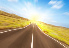 Asphalt road to the sun Royalty Free Stock Image