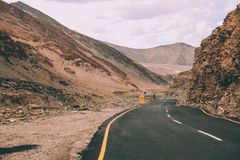 Asphalt road with traffic signs in Indian Himalayas,. Ladakh region stock photography