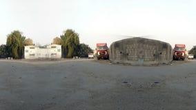 Asphalt road and trucks at afternoon loop stock video footage