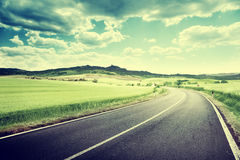 Asphalt road in Tuscan Royalty Free Stock Photography