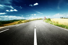 Asphalt road in Tuscany Royalty Free Stock Photo