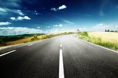 Asphalt road in Tuscany royalty free stock photo