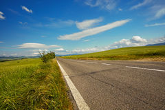 Asphalt road in Tuscany hills, Stock Photo