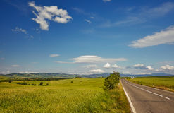 Asphalt road in Tuscany hills, Royalty Free Stock Image