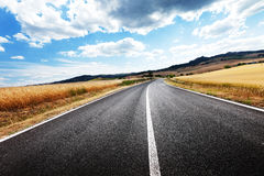 Asphalt road in Tuscany Royalty Free Stock Image