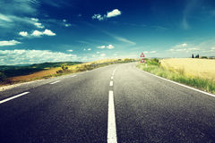 Asphalt road in Tuscany Royalty Free Stock Photos