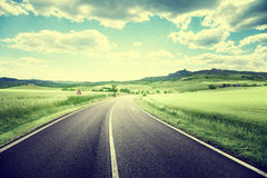 Asphalt road in Tuscany Stock Images