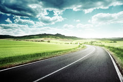 Asphalt road in Tuscany Royalty Free Stock Images