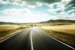 Asphalt road in Tuscany Stock Photography
