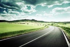 Asphalt road in Tuscany Stock Photo