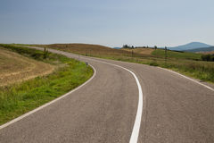 Asphalt road in Tuscany Italy. On a sunny day stock image