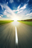 Asphalt road under blue sky Stock Photography