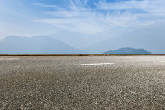 Asphalt road under the blue sky Royalty Free Stock Photo