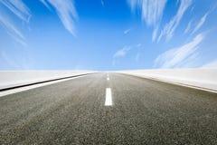 Asphalt road under the blue sky Stock Images