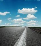 Asphalt road under blue sky royalty free stock photo