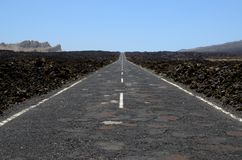 Asphalt road under blue sky Royalty Free Stock Photography