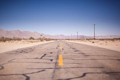 Asphalt Road Under the Clear Blue Skies during Daytime Royalty Free Stock Photos